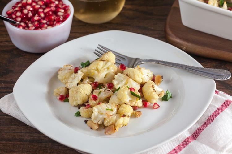 roast-cauliflower-with-pomegaranate-lemon-and-almonds-750x500